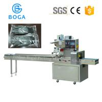 China Multi Function Pillow Packing Machine Surgical Glove Packing Meat Wrapping on sale