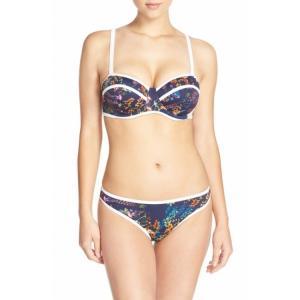 China White trim highlights the vibrant floral print set against the dark backdrop of a stylish bikini on sale