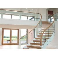 Buy cheap 40mm solid wood curved staircase With clear tempered glass railing from wholesalers