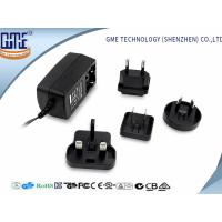 China 60950 60065 61558 Standard Black 9V 1A Universal AC DC Adapters wholesale