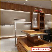 China High end luxury brush stainless steel furniture fixtures clothing display rack for clothing store wholesale