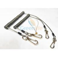 China Strong Anti - Drop Spring Steel Coil Tool Lanyard In Transparent Black Color wholesale