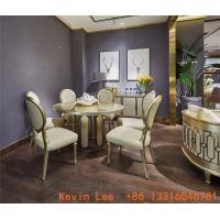 China Luxury dining room furniture circle table on golden leaf painting with Stainless steel legs used by Beech wood chairs on sale