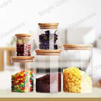 China Top Sale Clear Borosilicate Glass Candy Jars With Wooden Lid wholesale