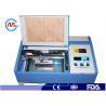China デスクトップ レーザーの彫刻家木製MDFのプラスチックのための小型CNCレーザーの打抜き機 wholesale