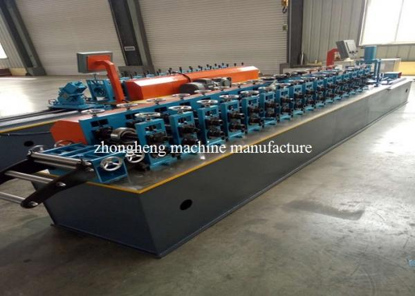 Quality Metal Window Section Roll Forming Machine With Servo Motor None Stop Cutting for sale