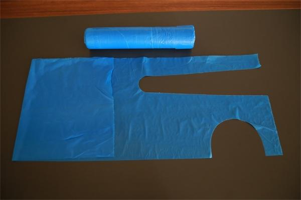 "Quality Blue Plastic Aprons Disposable On The Roll With Round Neck Waist Tie 26""X48"" for sale"