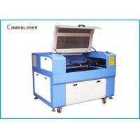 China Flat Rotary 6090 Acrylic Wood CO2 Laser Cutting Machine for Die Board Making wholesale