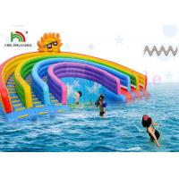 China Anti - UV Inflatable Water Parks Triple Lanes PVC Rainbow Slide With Swimming Pool For Rentals wholesale