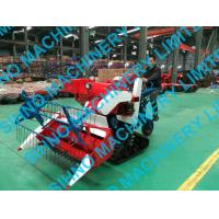 China 4L-0.7 mini wheat rice combine harvester with crawler on sale