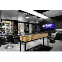 China Special Hairdressing salon interior fits out in Pine wood wall cabinets and Black metal shelves with Massage chair wholesale