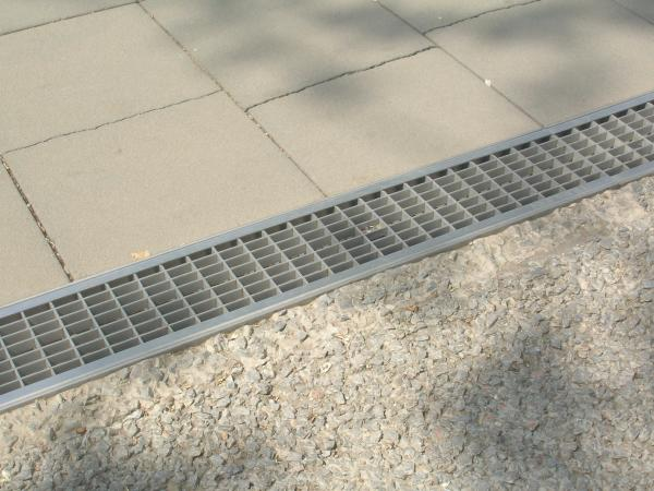 In Floor Pool Cleaning System metal drain covers images.