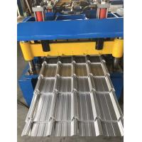 China Metal Trapezoidal Shape Step Roof Tile Roof Roll Forming Machine With Pressing Device wholesale