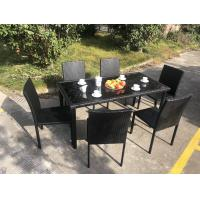China Stackable Chair Outdoor Rattan Dining Set KD Tabke With Black Glass wholesale