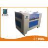 China Artículo completamente automático de la cortadora del grabado del laser del CO2 de 100 vatios con el refrigerador de agua wholesale