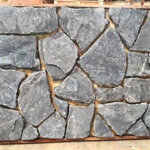 China Black Random Loose Limestone Stacked Wall Stone Abrasion Resistance wholesale