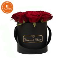 China Luxury high-end black circular paper flower box custom packaging box OEM service wholesale