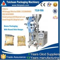 China low cost Fully automatic white pellet sugar bag packing machine,3 sides sealing bag Fully automatic white pell wholesale