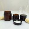 China Face cream amber glass jar with black plastic cap wholesale