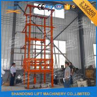 China 1T 12m CE Approved Vertical Guide Rail Elevators Hydraulic Warehouse Cargo Lift on sale