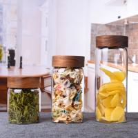 China Heat Resistant Glass Storage Bottle Jar With Acacia Wooden Screw Top Lid on sale