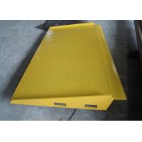 China Yellow Mobile Hydraulic Loading Ramp On Ground Loading And Unloading wholesale