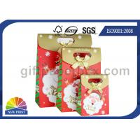 China Customized Christmas Gift Packaging Bag with Die Cut Handles Ribbon Bowknot wholesale