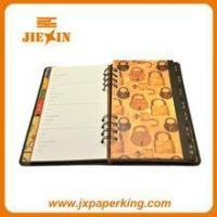 China plastic cover custom spiral notebook wholesale