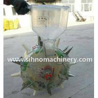Buy cheap mini manual hand pushing fertilizer and seed machine from wholesalers