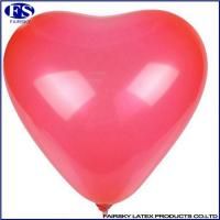 Heart-shaped balloon red