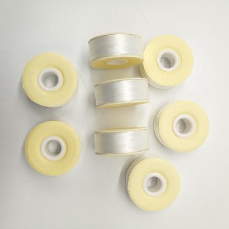 Quality White Bobbin paper side Size L 70D/2 Polyester for Embroidery 144pcs in a case for sale